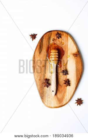 Honey Dipper On A Wooden Board