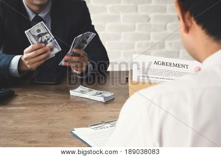 Business partner making an agreement - loan bribery and corruption concepts