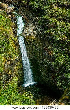 Waterfall cascades into pool on windward coast of Maui