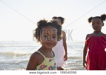 Black girls playing on beach