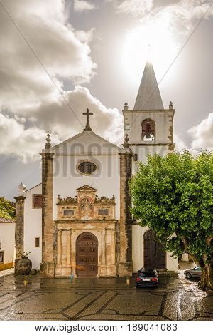 OBIDOS,PORTUGAL - MAY 11,2017 - View at the church of Santa Maria in Obidos town. The area of the town of Obidos is located on a hilltop encircled by a fortified wall.