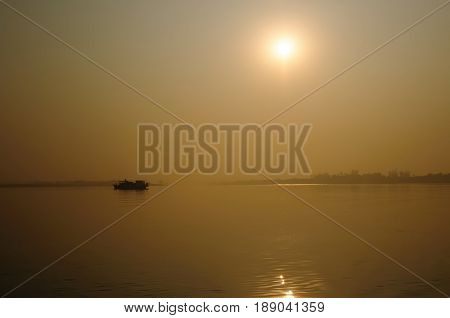 Sunset on the area of the biggest Ganges river delta of world in the west Bengal