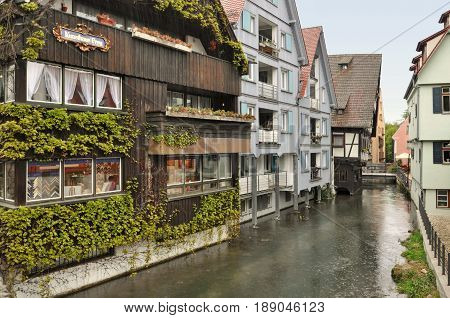 Ulm, Baden-Wurttemberg, Germany - April 25, 2017: Ancient half-timbered houses with green ivy in the fishermen's quarter in Ulm.