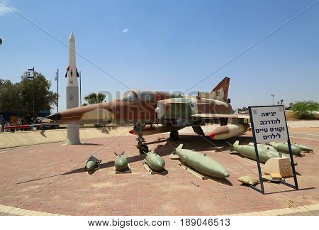 HATZERIM, ISRAEL - MAY 2, 2017: The Israel Aircraft Industries Kfir with its typical weapon loadout on display at the Israeli Air Force Museum.