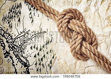 Close-up View Of A Rope Sea Knot On An Old Retro Map