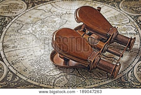 Close-up View Of A Vintage Binoculars On An Old Retro Map