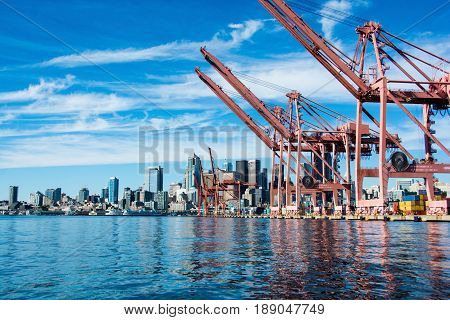 Seattle waterfront and container cranes viewed from Elliott Bay