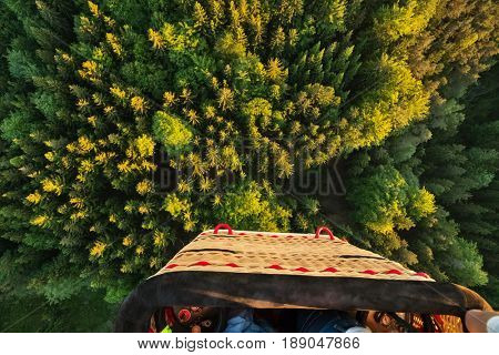 View from basket in hot air balloon, flying above rural countryside. Air travel and transportation, beautiful nature landscape shot from aerial perspective
