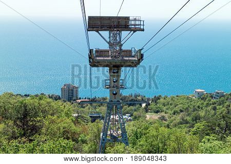 Crimea cable car to Ai-Petri mountain view from the cabin funicular at sea and interchange area