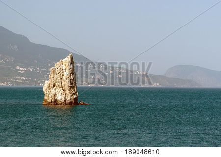 The swallows nest a lonely promontory in the black sea view on Yalta