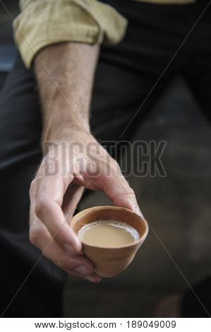 Hand holding cup of tea