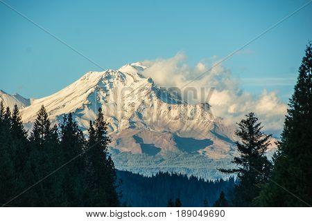 Snow blowing off summit of Mt Shasta, California