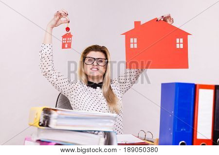 Happy Business Woman In Office Holding House