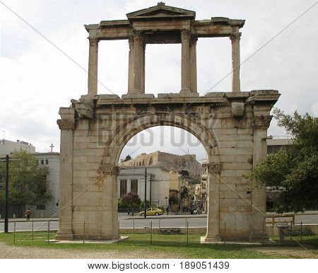 The Arch of Hadrian or Hadrian's Gate with the Acropolis of Athens in the Background, Athens, Greece