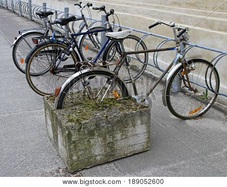Art Composition Of Bicycle With Rear Wheel Stucked In Concrete