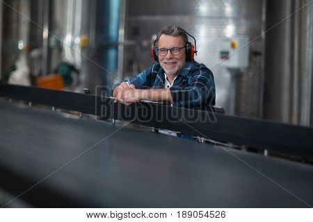 Portrait of male factory worker at drinks production factory