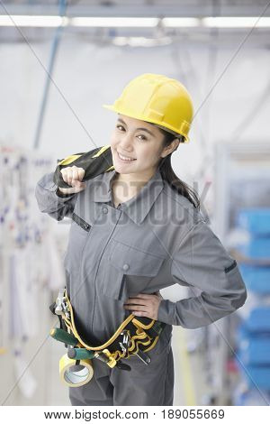 Chinese worker wearing tool belt