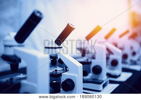 series of microscopes of monochrome color and with a glare. Concept of biology and research medical equipment.