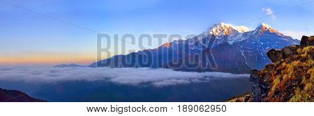 Mountain Landscape in Himalaya. Above clouds. Annapurna South peak. Nepal, Mardi Himal track.