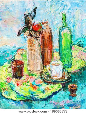 Still life with bottles on motley cloth