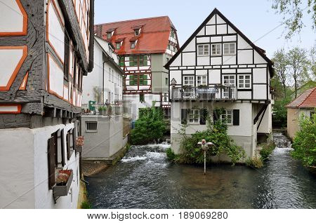 Ancient half-timbered buildings in the fishermen's quarter in Ulm, Baden-Wurttemberg, Germany. House standing on the water channel.