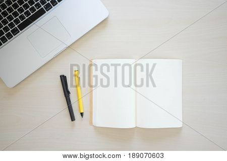 Office table with computer, book pen , pencils and phone
