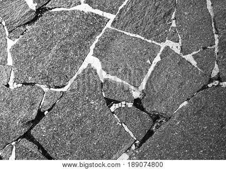Paving slabs. Granite paving slabs.Stone road .