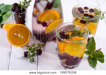 Fruit and herb infused water. Cold refreshing vitamin detox water. Summer drink