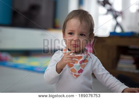 Small cute little girl at home crying very much