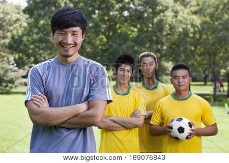 Chinese soccer players in park