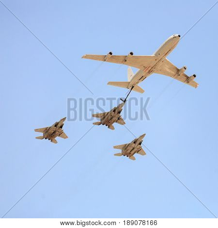 BEER-SHEBA ISRAEL - may 02 2017: Three F-15 fighter with Boeing 707 tanker at Independence Day