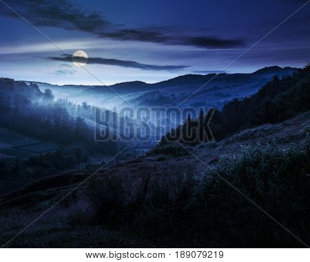 Foggy Hillside In Rural Area At Night