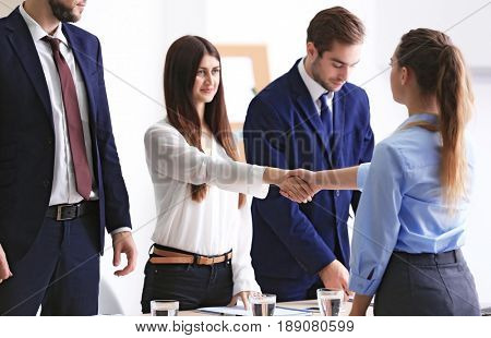 Employer and applicant shaking hands after interview