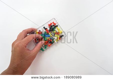 isolated business stationary - people use colorful thumbtack for business purpose