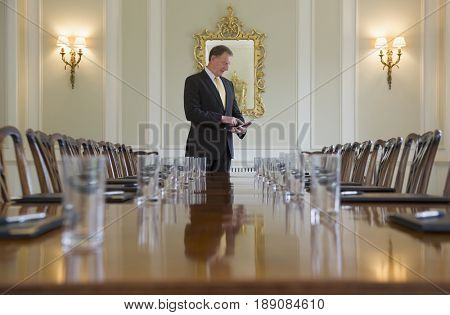 Caucasian businessman at meeting table