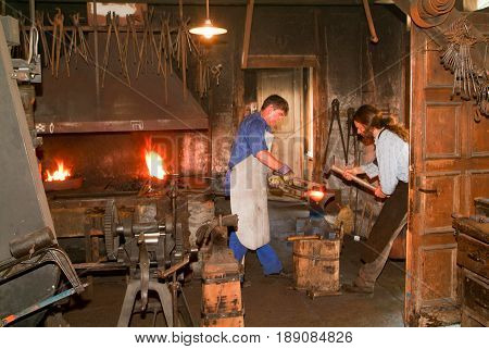 Two Blacksmith Working In The Smithy At Ballenberg