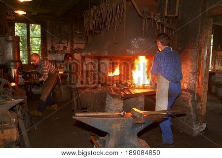 Tree Blacksmith Working In The Smithy At Ballenberg