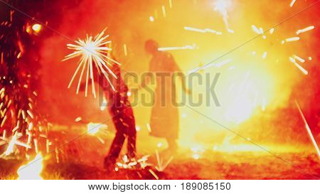Colorful fireworks show at night - blurred, telephoto