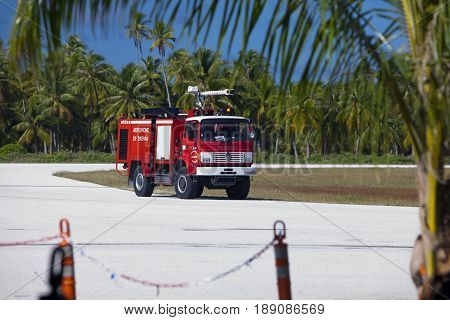 POLINESIA- JUNE 16: Fire-engine on a take-off field of small tropical island Tikehau on june 16 2011 in Polynesia.