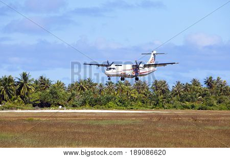 POLINESIA- JUNE 16: screw plane - ATR 72 Air Tahiti companies makes landing on the small tropical island Tikehau on june 16 2011 in French Polynesia