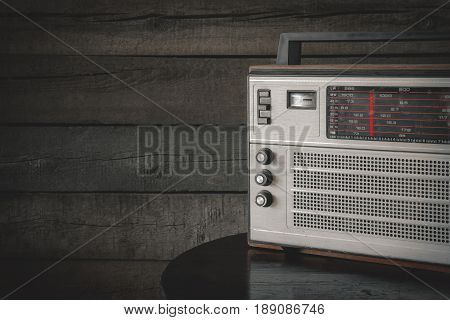 The old transistor radio stands on the table in the village house