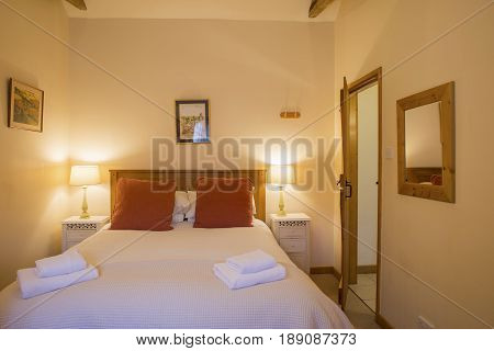 View Of Furnished Vacation House Bedroom With Illuminated Lampshades