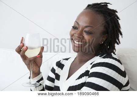 Black woman drinking white wine