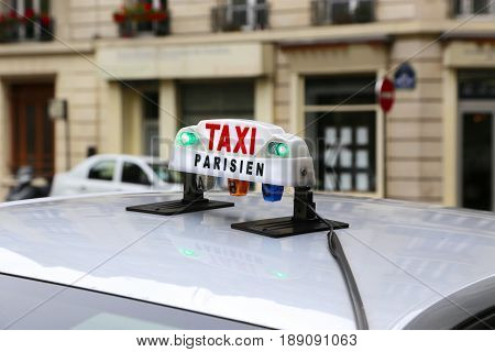 Clodeup of taxicab sign in Paris, France