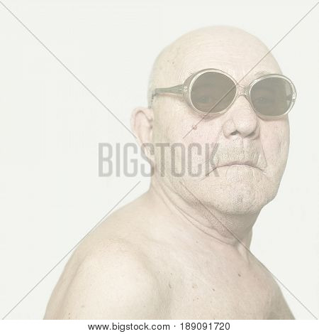 Older Caucasian man wearing sunglasses