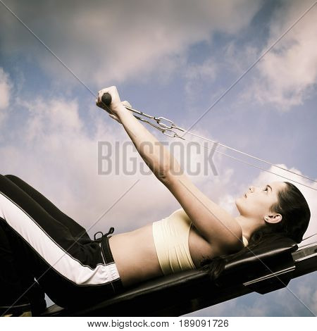 Woman using exercise machine outdoors