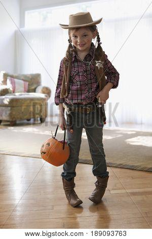 Caucasian girl wearing sheriff costume