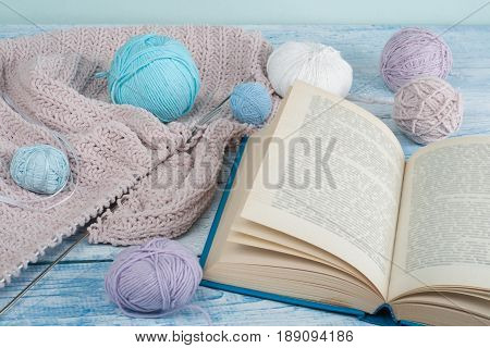 Handmade gift for special day as mother day, father day, valentine day or wintertime, heap of ball of wool to knit colorful scarf for cold day, knitting to make special meaningful vintage blue present