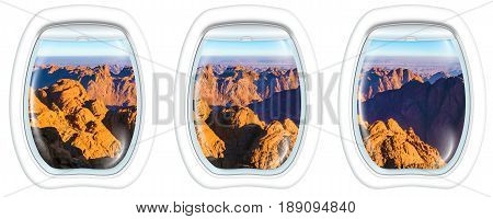 Three porthole frame windows on the holy summit of Mount Sinai, Aka Jebel Musa, 2285 meters, at sunrise, Sinai Peninsula in Egypt. Spirituality, religion and history concept.