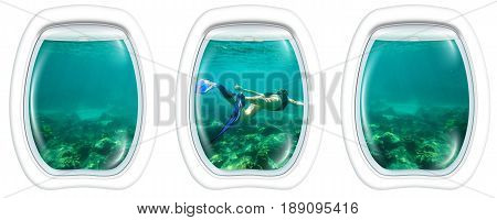 Three porthole frame windows of underwater submarine ship on Female apnea swims in tropical turquoise sea of Racha Noi, Phuket in Thailand.